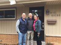 Jeff & Tracy with Kevin in front of their new home in Menomonee Falls!