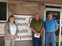 Administrator Pam Burnett, Board Member Ron Thomas, and Assistant Administrator Todd Fickbohm