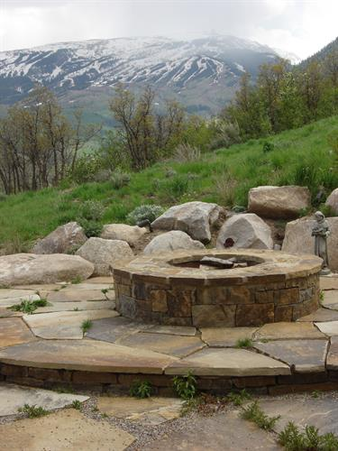 Rustic fire pit in xeriscape patio