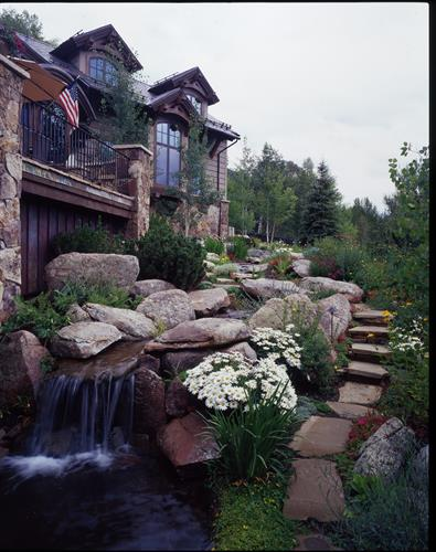Waterfall and patio with firepit