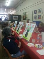 Adults having fun painting!