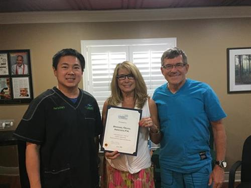 Dr. Lu, Pat, and Dr. A celebrating 5 years of Chamber membership.