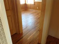 Two inch solid oak flooring installed over existing oak flooring that was treated as a sub flooring.