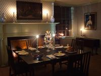 Candlelit dining room at the Schuyler Estate