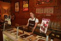 Emily ready to serve you freshly made fudge!