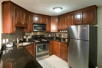 Updated kitchens with granite counters, cherry finish cabinetry,and stainless steel appliances.