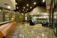 Grand lobby entrance with 24/7 Concierge services