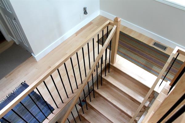 Stairway - Maple stair treads, railings and metal balusters