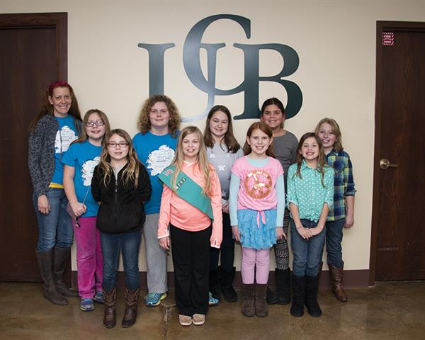 Junior Girl Scout Troup 6252 touring UCB for an informative bank tour.