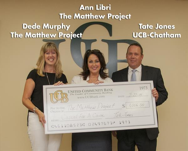 UCB's Tate Jones presenting Representatives from the Matthew Project with $1,006.00 from our Casual for a Cause Program