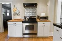 Kitchen area stove and cabinets