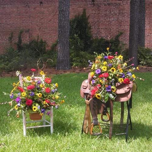 An interesting tribute for the fantastic lady. The flowers in these arrangements are all locally grown