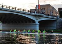 Youth rowing under the High-Main Bridge