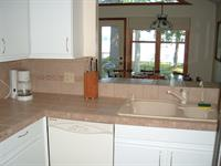 kitchen with dining room and lake out front window