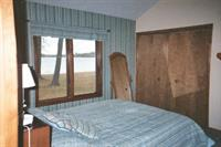 master en suite bedroom with king bed