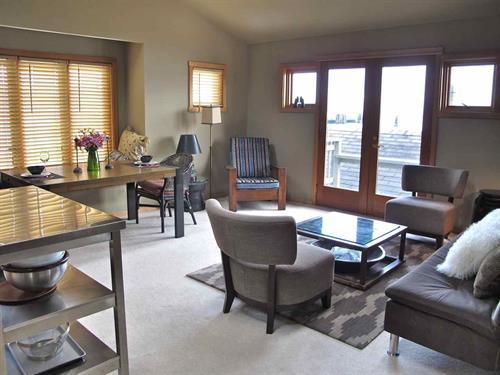 Living room with door to view deck
