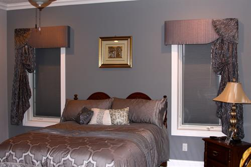 Fan cornice with Italian strung cascades, bedspread, shams and decorative pillows