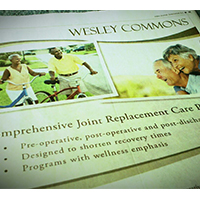Half-page newspaper ad for Wesley Commons