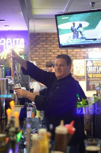 Chuck pouring a beer