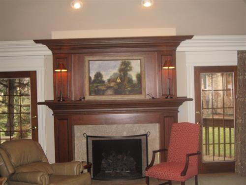 Built in fireplace mantle Stained on site and varnished.