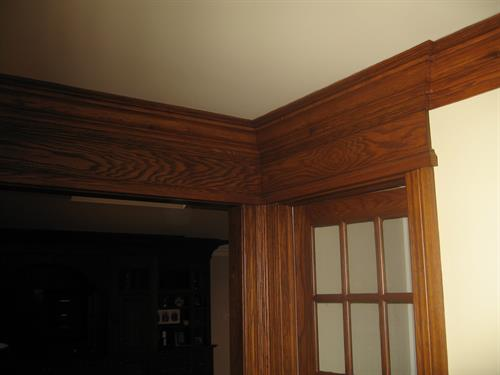 New crown molding stained and varnished to match the existing trim.