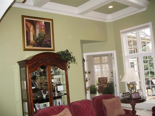 Interior painting with a coffered ceiling.