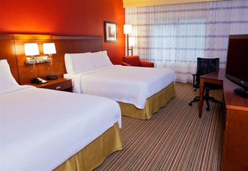 Our comfortable double rooms feature two queen-sized beds.