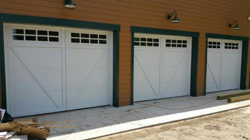 Three of a kind. Brand new Overhead Doors from Tampa's original garage door company.