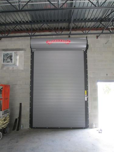 Our commercial doors are solid like this Roll Up Steel Door.