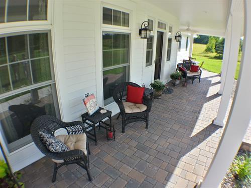 The Farmhouse porch invites you