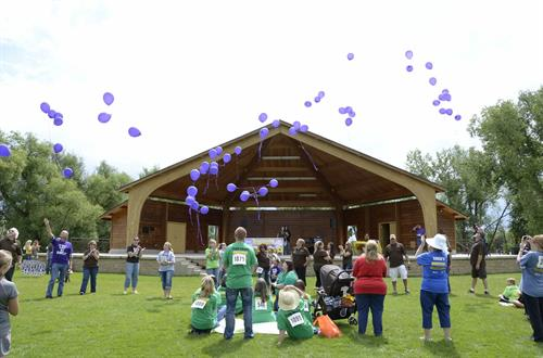 Purple balloons are passed throughout the entire audience and hugs are shared from complete strangers that are there to support one another.