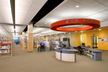 "Visibly marked ""Ask Here"" desks on all three floors"