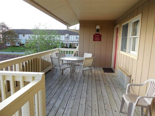 The deck and patio set if you stay on our Lake view Room!