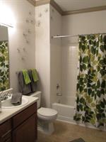 Spacious Bathrooms with linen closet