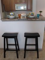 42 inch oak cabinets, breakfast bar, faux granite counters
