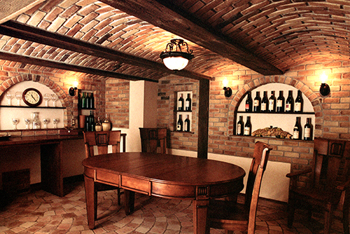 Basement remodel—recreated old-world european wine cellar with barrel ceiling