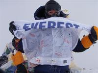 Lori Schneider on summit of Mt. Everest at 29,039ft. - May 2009