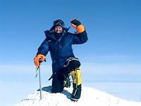 Lori Schneider on summit of Denali, North America's highest peak!