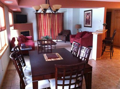 Large dining, living, breakfast bar area.