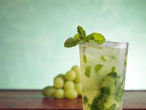 Mojito de Uvas - Bacardi Superior Rum, fresh squeezed lime juice, cane sugar syrup, fresh mint and green grapes, topped with chilled Champagne. Garnished with fresh mint.