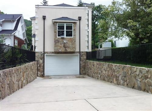 Below-grade garage addition with elevator