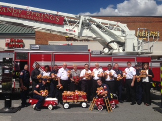 Fran Farias donates 100 Bears to the Sandy Springs Fire Department