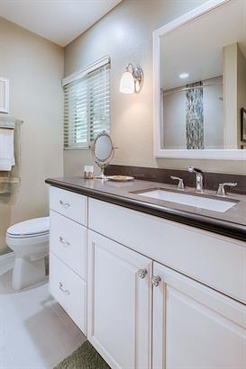 bathroom remodel with white cabinetry