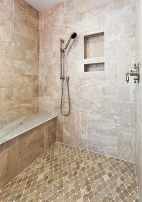 Shower enclosure and flooring in tile and stone