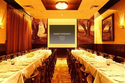 Private dining in the Cucina Room with presentation screen