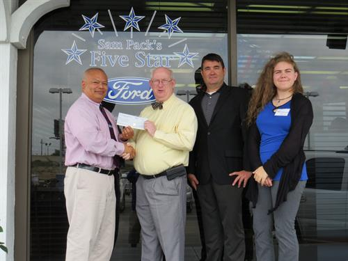 A $5,900 Check from the Ford Motor Corporation & Sam Pack's Five Star Ford - Carrollton was donated to the CFBISD Educational Foundation.