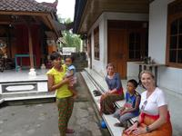 With our Taxi driver's family in their home- Bali