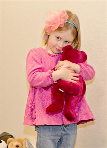 Gallery Image Young_Girl_hugging_bear.jpg