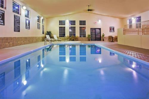 Relax in enjoy our 24-hour large indoor pool and spa. A relaxing area is just off the pool area for lounging.