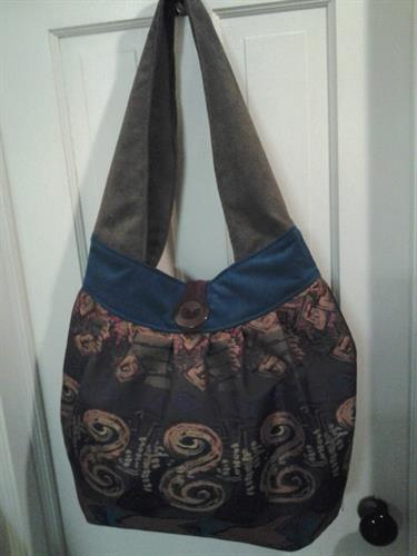 bucket style purse with decorator fabric and suede accents